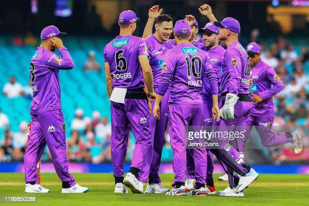 The Hurricanes celebrate the wicket of James Vince during the Big Bash League match between the Sydney Sixers and the Hobart Hurricanes at the Sydney...