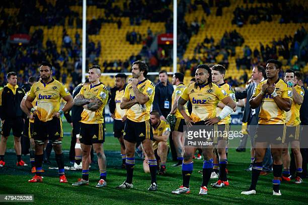 The Hurricanes look dejected as they wait for the trophy presentation following the Super Rugby Final match between the Hurricanes and the...