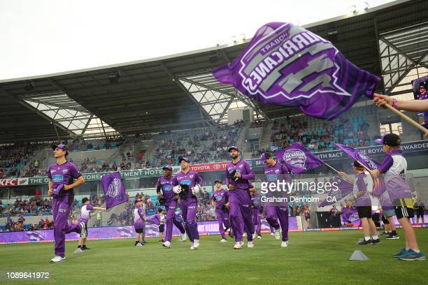 The Hurricanes run onto the pitch during the Big Bash League match between the Hobart Hurricanes and the Sydney Sixers at Blundstone Arena on January...