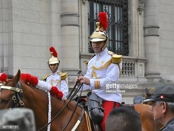 CONTENT] The Husares de Junin horse mounted cavalry presidential guard at the Presidential Palace in old historic downtown Lima Peru on a typical...