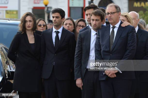 The husband and sons of murdered journalist Daphne Caruana Galizia stand by the hearse before her funeral ceremony at the church of Mosta Dome in...