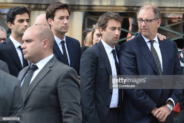 The husband and sons of murdered of murdered journalist Daphne Caruana Galizia attend her funeral ceremony at the church in Mosta on November 3 2017...