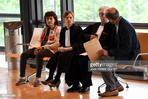 The husband of French cycling great Jeannie Longo Patrice Ciprelli talks with his lawyer Andre Soulier at the courthouse of Grenoble prior to an...