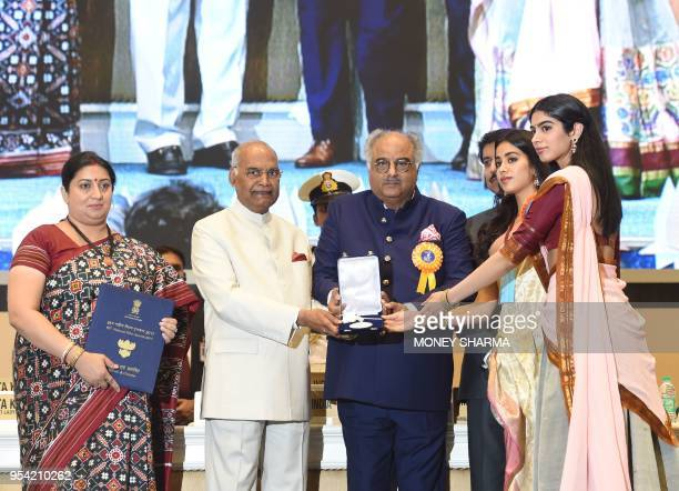The husband of late Bollywood actress Sridevi Kapoor Boney Kapoor and her daughters Janhvi and Khushi Kapoor receive the national best actress on her...