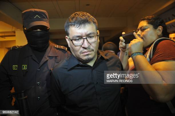 The husband of murdered Salvadorean journalist Karla Turcios Mario Huezo is escorted by the police after being arrested for her crime in San Salvador...