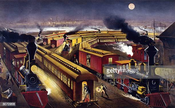 The hustle and bustle of a US railroad station at nighttime Original Artwork Printed by Currier and Ives
