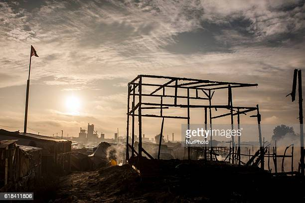 The huts of refugees caught fire in the day in the jungle There are only smoldering structures in Calais October 26 2016 The jungle of Calais is...