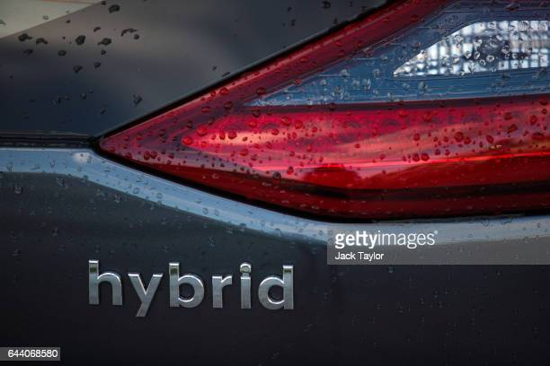 The Hybrid logo is displayed on a Hyundai Ioniq hybrid car during a photocall by the Society Of Motor Manufacturers in Potters Field on February 23...