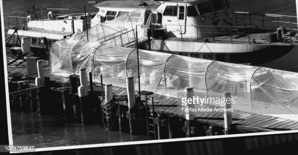 The hydrofoil Curl Curl sits at the UTA workshop Balmain where plastic covers the exit of the craft leading to a shed on the wharf June 30 1987