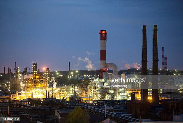 The hydrogen production unit center sits illuminated by light during evening operations at the BashneftUfaneftekhim oil refinery operated by Bashneft...