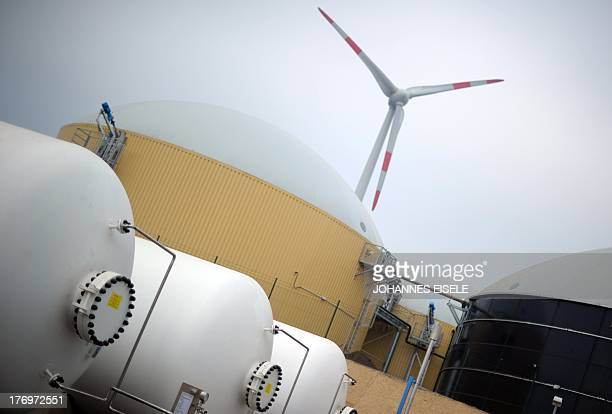 The hydrogen storage the biogas storage and a wind turbine are seen at the hybrid power plant on October 25 2011 in Prenzlau eastern Germany The...