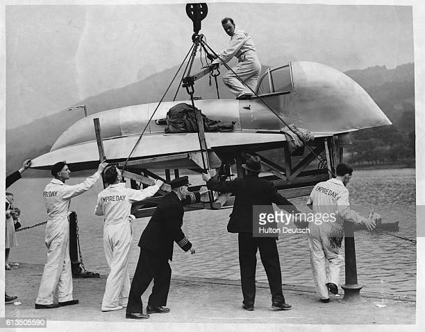 The hydroplane Empire Day which was built by Edward Spurr and designed by Spurr and T E Lawrence is lowered into Lake Windermere ready for an attempt...