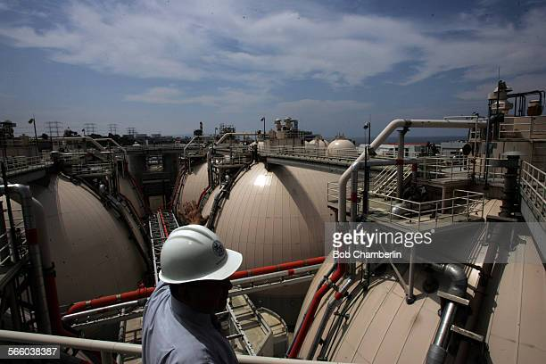The Hyperion water treatment plant manager Steve Fan walks along catwalk four stories above their giant dome shaped digesters where waste water from...