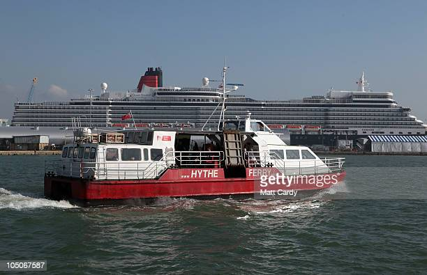 The Hythe ferry passes Cunard's newest liner the Queen Elizabeth after she arrived at Southampton on October 8 2010 in Southampton England The...