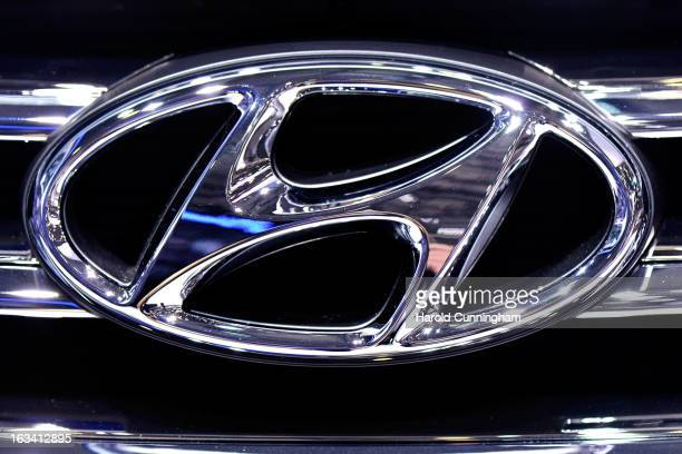 The Hyundai logo is seen during the 83rd Geneva Motor Show on March 6 2013 in Geneva Switzerland Held annually with more than 130 product premiers...