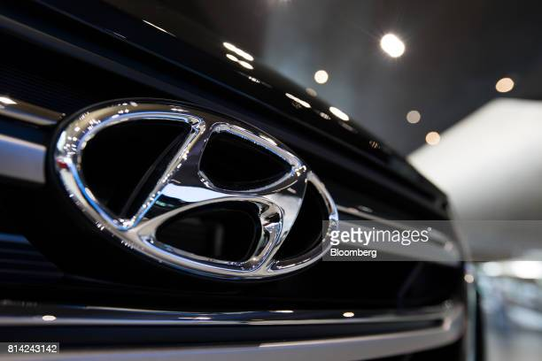 The Hyundai Motor Co badge is displayed on the front grille of a vehicle at the Hyundai Motorstudio showroom in Goyang South Korea on Friday July 14...