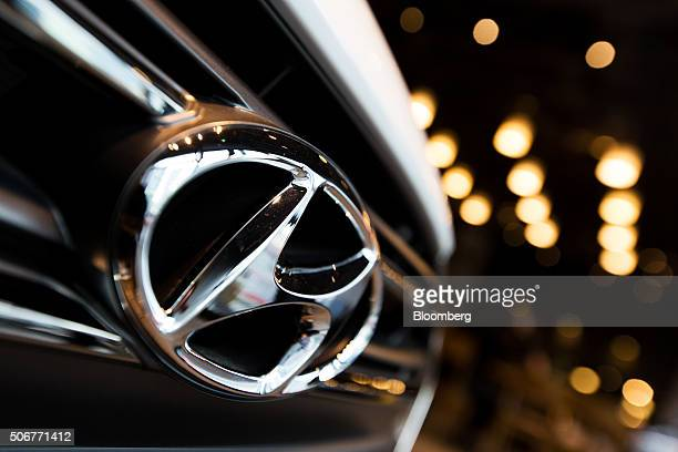 The Hyundai Motor Co badge is displayed on the front grille of an Avante sedan at a company dealership in the Gangnam district of Seoul South Korea...