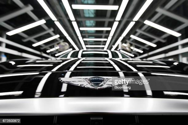 The Hyundai Motor Co Genesis badge is seen on the hood of the sedan on the production line at the company's plant in Ulsan South Korea on Monday...