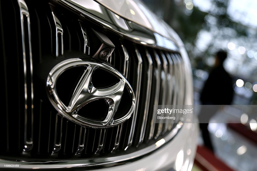 The Hyundai Motor Co. logo is displayed on the front grille of a 5G Grandeur sedan in the showroom at the company's headquarters in Seoul, South Korea, on Tuesday, Jan. 22, 2013. Hyundai Motor Co. is scheduled to release fourth-quarter earnings on Jan. 24. Photographer: SeongJoon Cho/Bloomberg via Getty Images