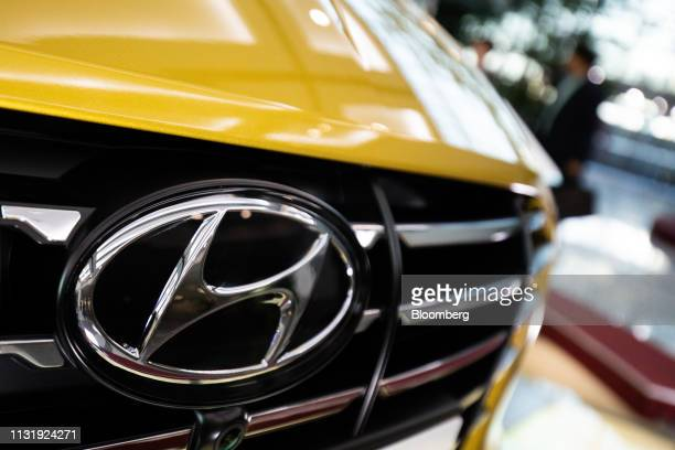 The Hyundai Motor Co logo is displayed on the front grille of a Sonata sedan at the company's headquarters in Seoul South Korea on Friday March 22...