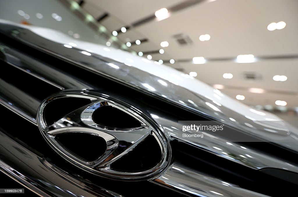 The Hyundai Motor Co. logo is displayed on the front grille of a Sonata sedan at a dealership in Seoul, South Korea, on Tuesday, Jan. 22, 2013. Hyundai Motor Co. is scheduled to release fourth-quarter earnings on Jan. 24. Photographer: SeongJoon Cho/Bloomberg via Getty Images
