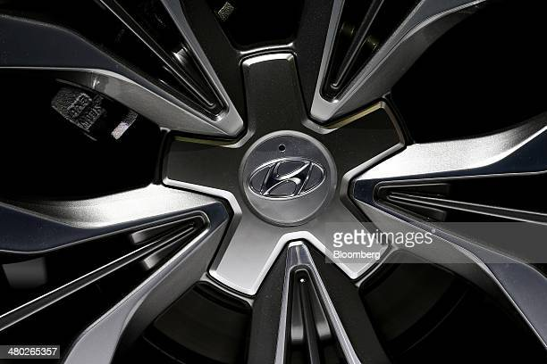 The Hyundai Motor Co logo is displayed on the hubcap of the company's new Sonata sedan during an unveiling ceremony in Seoul South Korea on Monday...