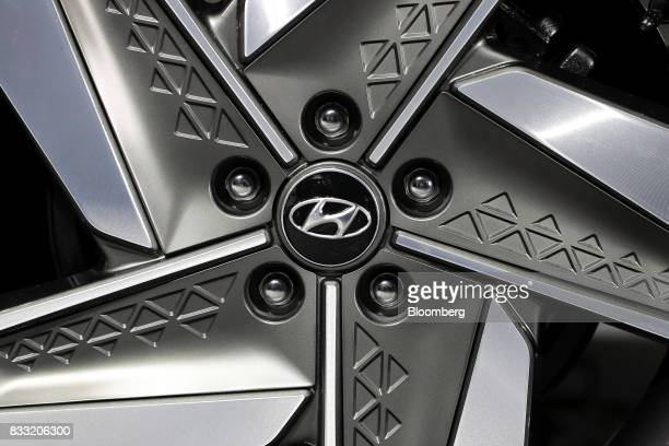 The Hyundai Motor Co logo is displayed on the wheel cap of its next generation fuelcell electric sport utility vehicle during an unveiling event in...