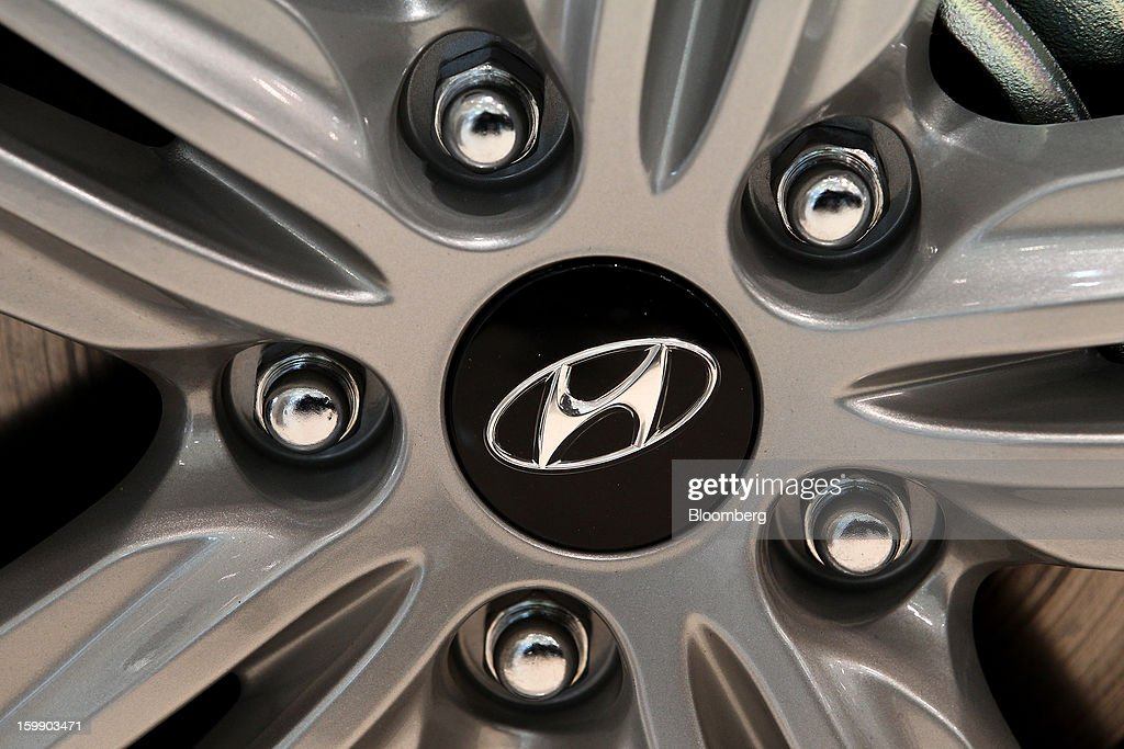 The Hyundai Motor Co. logo is displayed on the wheel cover of a Sonata sedan at a dealership in Seoul, South Korea, on Tuesday, Jan. 22, 2013. Hyundai Motor Co. is scheduled to release fourth-quarter earnings on Jan. 24. Photographer: SeongJoon Cho/Bloomberg via Getty Images