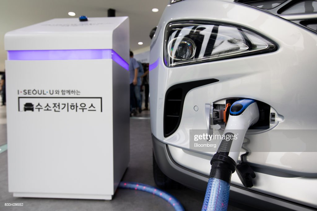 The Hyundai Motor Co. next generation fuel-cell electric sport utility vehicle (SUV) provides electricity to external equipment during an unveiling event in Seoul, South Korea, on Thursday, Aug. 17, 2017. Hyundai said that electric vehicles will underpin its push into environmentally friendly cars, the latest automaker to embrace battery-powered vehicles after earlier bets on hydrogen fuel-cell cars. Photographer: SeongJoon Cho/Bloomberg via Getty Images
