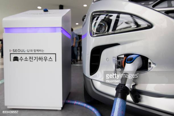 The Hyundai Motor Co next generation fuelcell electric sport utility vehicle provides electricity to external equipment during an unveiling event in...