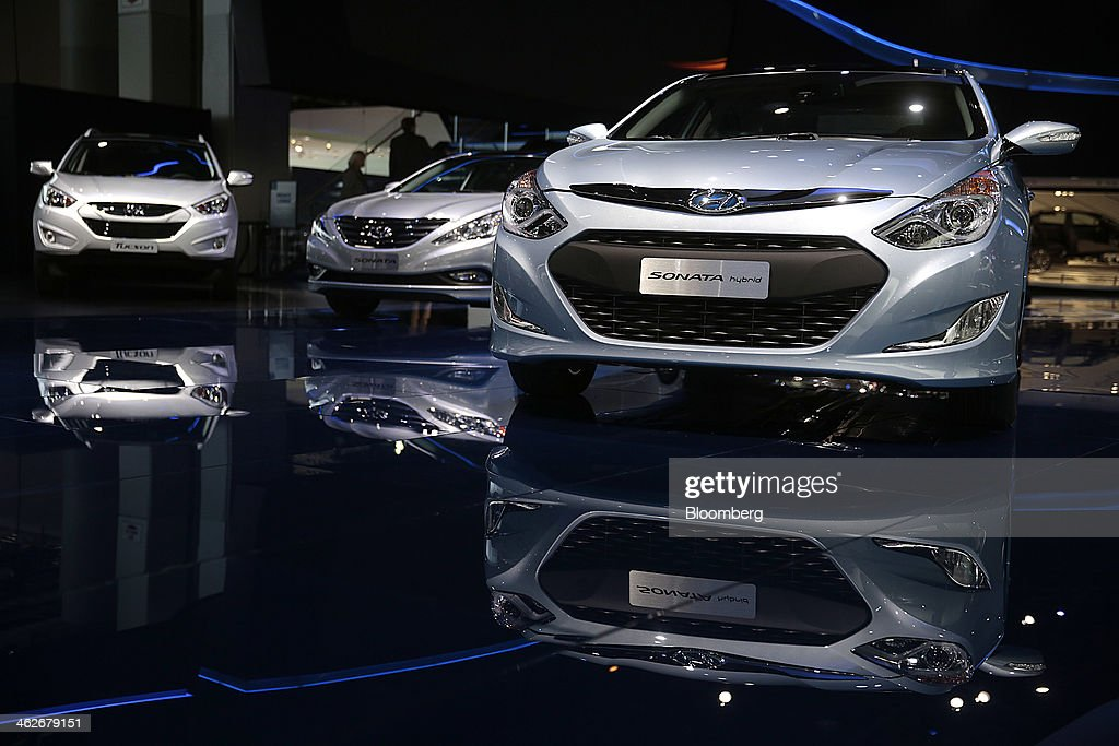 The Hyundai Motor Co. Sonata hybrid vehicle is displayed during the 2014 North American International Auto Show (NAIAS) in Detroit, Michigan, U.S., on Tuesday, Jan. 14, 2014. Hyundai Motor America, after lackluster U.S. growth in 2013, introduced a restyled 2015 Genesis sedan yesterday with a heftier look, with a broad front grille and sculpted body panels, and is the first Hyundai sedan with optional all-wheel-drive, the company said. Photographer: Andrew Harrer/Bloomberg via Getty Images