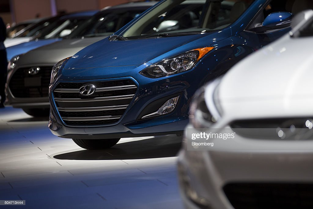 The Hyundai Motor Corp. Elantra GT vehicle, center, sits on display during the 2016 North American International Auto Show (NAIAS) in Detroit, Michigan, U.S., on Tuesday, Jan. 12, 2016. Last year's auto show featured 55 vehicle introductions, a majority of which were worldwide debuts, and was attended by over 5,000 journalists from 60 countries. Photographer: Andrew Harrer/Bloomberg via Getty Images