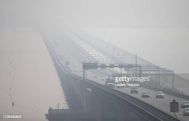 The I-90 bridge over Lake Washington disappears through heavy smoke from wildfires on September 11, 2020 in Seattle, Washington. According to...