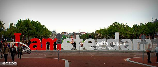 CONTENT] The Iamsterdam sign from behind in Museumplein Amsterdam surrounded by tourists posing for photographs