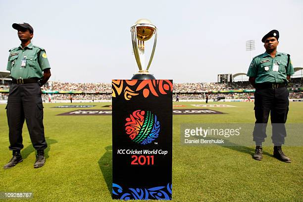 The ICC Cricket World Cup is displayed under guard during the opening game of the ICC Cricket World Cup between Bangladesh and India at the...