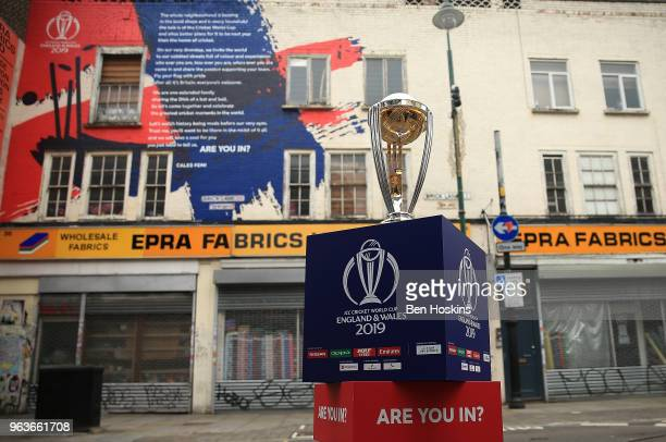 The ICC Cricket World Cup trophy on display on Brick Lane infront of the World Cup declaration mural by London poet Caleb Femi on May 30 2018 in...