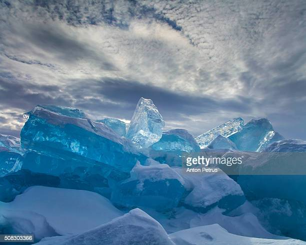 The ice at Lake Baikal on the background of dramatic sky