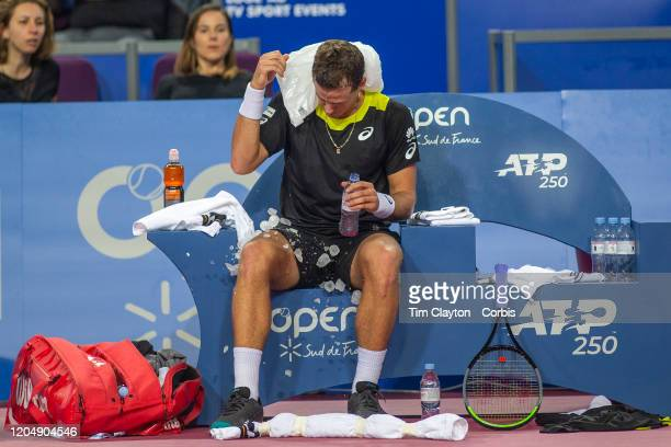 The ice bag breaks for Vasek Pospisil of Canada as he attempts to cool off during a change of ends during his match against David Goffin of Belgium...