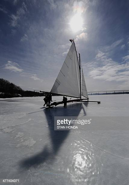 The ice boat Jack Frost prepares to sail across a frozen Hudson River March 7 2014 in Barrytown New York These historic 'ice yachts' some dating to...