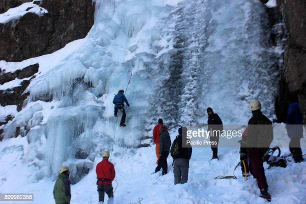 The ice climbers scale an ice wall at Chandanwari in Pahalgam
