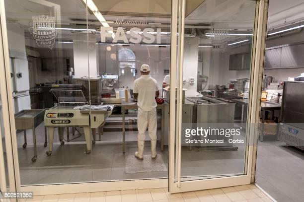 The ice cream maker prepares the ice cream in the Fassi icecream parlor Lab The Palazzo del Freddo means Palace of the Cold di Giovanni Fassi is the...