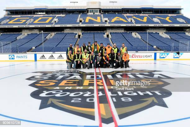 The ice crew gathers during a break in preparations for the 2018 Coors Light NHL Stadium Series game at NavyMarine Corps Memorial Stadium on February...