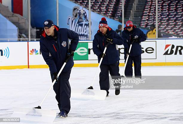 The ice crew tends to the ice during the 2015 Bridgestone NHL Winter Classic practice day on December 31 2014 at Nationals Park in Washington DC The...