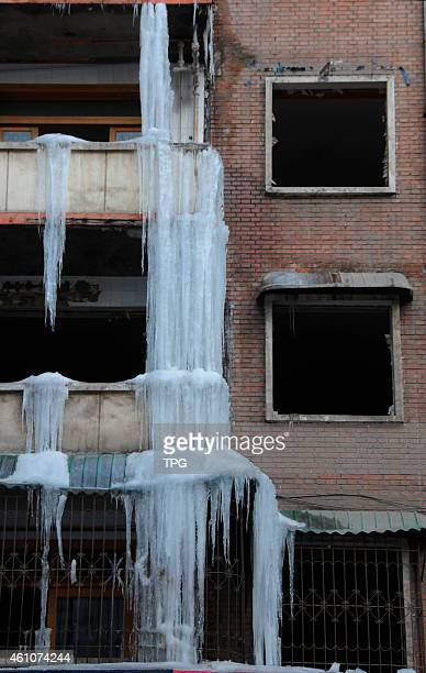 The ice fall appears on a demolition building because of leaking water pipe on 06th January 2015 in Taiyuan Shanxi China