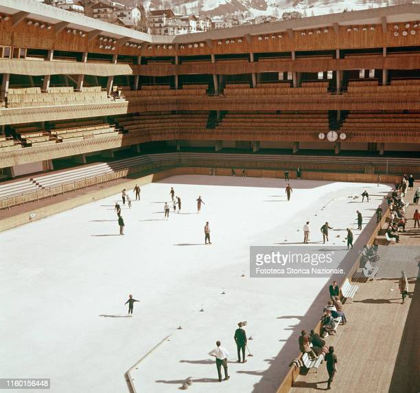 The Ice Palace, frequented by adults and children even in summer, skating and playing curling. Photograph, Italy, Cortina d'Ampezzo approx. 1960.