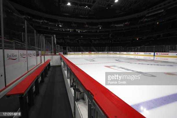 The ice player's bench and spectator seating are empty prior to the Detroit Red Wings playing against the Washington Capitals at Capital One Arena on...