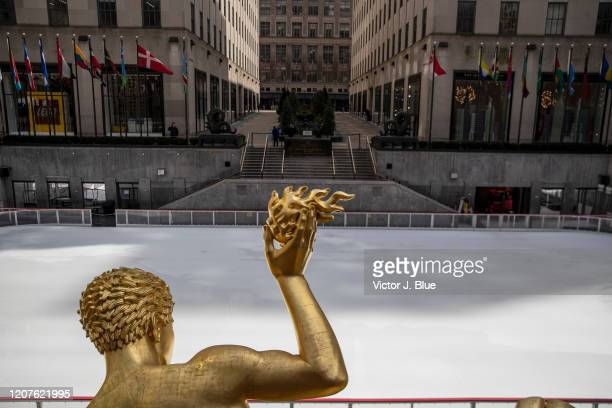 The ice skating rink at Rockefeller Center is empty as it sits closed in the wake of the Coronavirus COVID19 outbreak on March 18 2020 in New York...