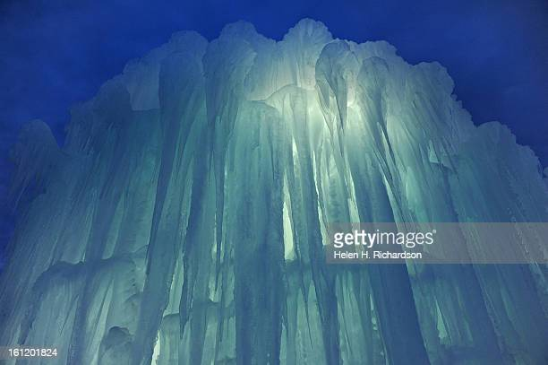 The ice takes on beautiful features as it becomes illuminated with light on the inside as the sun sets The Ice Castles at Silverthorne are an...