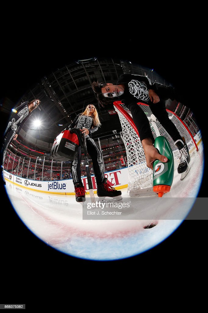 The ice technical crew prepares the goal crease while wearing Halloween costumes prior to the Florida Panthers hosting the Tampa Bay Lightning at the BB&T Center on October 30, 2017 in Sunrise, Florida.
