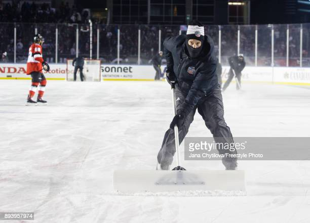 The icecrew clears the snow during a timeout during a game between the Ottawa Senators and the Montreal Canadiens during the of the 2017 Scotiabank...